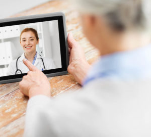 Clinician pictured in remote consultation with patient