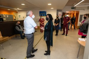 Cleo meeting Sir David Sloman, NHS Regional Director for London at a recent visit to the North Lewisham and Alliance PCN Covid Vaccination Hub at the Waldron Health Centre, to talk about her experiences of talking to people who are vaccine hesitant